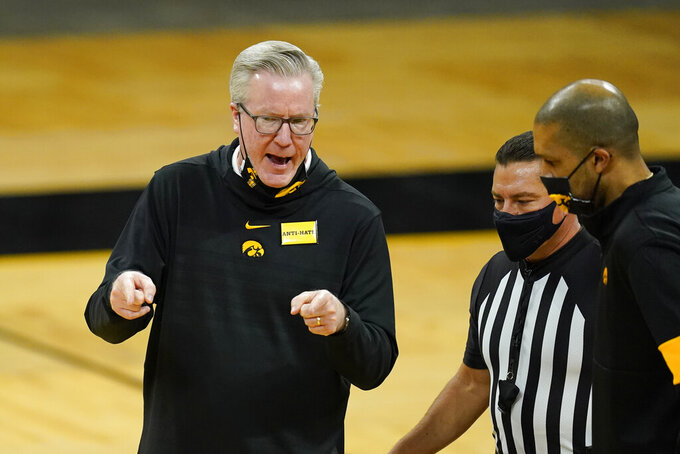 Iowa head coach Fran McCaffery, left, questions a call against his team during the second half of an NCAA college basketball game against Western Illinois, Thursday, Dec. 3, 2020, in Iowa City, Iowa. (AP Photo/Charlie Neibergall)