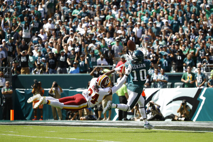 Philadelphia Eagles' DeSean Jackson, right, catches a touchdown pass against Washington Redskins' Josh Norman during the first half of an NFL football game Sunday, Sept. 8, 2019, in Philadelphia. (AP Photo/Matt Rourke)