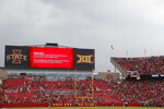 Fans are asked to leave the stadium after lightning was spotted during the first half as South Dakota State takes on Iowa State in an NCAA college football game, Saturday, Sept. 1, 2018, in Ames, Iowa. (AP Photo/Matthew Putney)