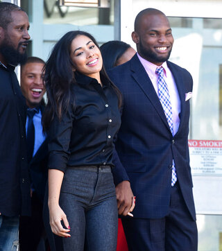 Leonte Carroo leaves the Middlesex County Courthouse his hearing to make a temporary restraining order against him permanant. He is flanked by his girlfriend Maria Vega and mother Laverne Carroo.