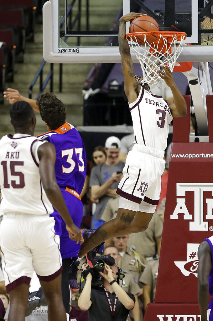 Texas A&M guard Quenton Jackson (3) dunks against Northwestern State during the first half of an NCAA college basketball game Wednesday, Nov. 6, 2019, in College Station, Texas. (AP Photo/Sam Craft)