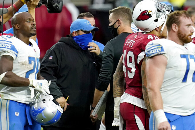 Detroit Lions head coach Matt Patricia, left, greets Arizona Cardinals head coach Kliff Kingsbury after an NFL football game, Sunday, Sept. 27, 2020, in Glendale, Ariz. The Lions won 26-23. (AP Photo/Ross D. Franklin)