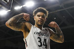 Cincinnati's Jarron Cumberland reacts after scoring during the first half of the team's NCAA college basketball game against SMU, Tuesday, Jan. 28, 2020, in Cincinnati. (AP Photo/John Minchillo)