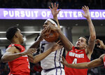 Northwestern center Dererk Pardon, center, vies for a rebound against Ohio State guards C.J. Jackson, left, and Duane Washington Jr. during the second half of an NCAA college basketball game Wednesday, March 6, 2019, in Evanston, Ill. (AP Photo/Nam Y. Huh)