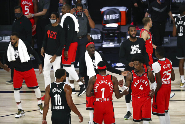 Toronto Raptors forward Pascal Siakam (43) and the Raptors celebrate the game and series victory against the Brooklyn Nets following Game 4 of an NBA basketball first-round playoff series, Sunday, Aug. 23, 2020, in Lake Buena Vista, Fla. (Kim Klement/Pool Photo via AP)