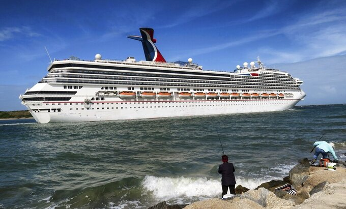 FILE - In this March 9, 2020 photo, the Carnival Liberty leaves Port Canaveral, Fla. Carnival Cruise Line said Monday, Jan. 25, 2021, is cancelling and delaying more U.S. sailings as it continues to suffer from the pandemic's fallout. (Joe Burbank/Orlando Sentinel via AP, File)
