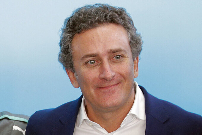 "FILE - In this Oct. 19, 2017, file photo, Alejandro Agag poses during a press conference, in Rome. Andretti Autosport and Chip Ganassi Racing are the first two American teams to commit to a new electric SUV off-road racing series scheduled to begin in 2021.  The Extreme E series has five events planned in what the league is calling ""some of the most remarkable, remote and severely damaged locations on the planet."" ""Extreme E is an ambitious new project born out of a concern for the future of our planet, and now more than ever, as motorsport adapts its behaviors and values to stay relevant in these changing times, that concern is critical for us all to consider,"" Agag, founder of both Formula E and Extreme E said. (AP Photo/Andrew Medichini, File)"