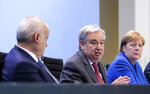From left, U.N. Envoy for Libya, Ghassan Salame, United Nations Secretary-General Antonio Guterres and German Chancellor Angela Merkel attend a news conference after the conference on Libya at the chancellery in Berlin, Germany, Sunday, Jan. 19, 2020. (Axel Schmidt/Pool Photo via AP)