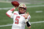 FILE - In this Saturday, Nov. 14, 2020, file photo, Boston College quarterback Phil Jurkovec throws a pass against Notre Dame during the first half of an NCAA college football game in Boston. The Notre Dame transfer is hoping to keep the Eagles moving in Saturday's game against Louisville. (AP Photo/Michael Dwyer, File)