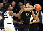 Colorado's Eli Parquet, left, defends Sacramento State's Ethan Esposito in the first half of an NCAA college basketball game, Saturday, Nov. 30, 2019, in Boulder, Colo. (AP Photo/Cliff Grassmick)