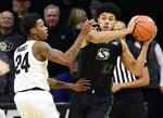 Colorado's Eli Parquet, left, defends Sacramento State's Ethan Esposito in the first half of an NCAA college basketball game, Saturday, Nov. 30, 2019, in Boulder, Colo. (AP Photo/Cliff Grassmick)