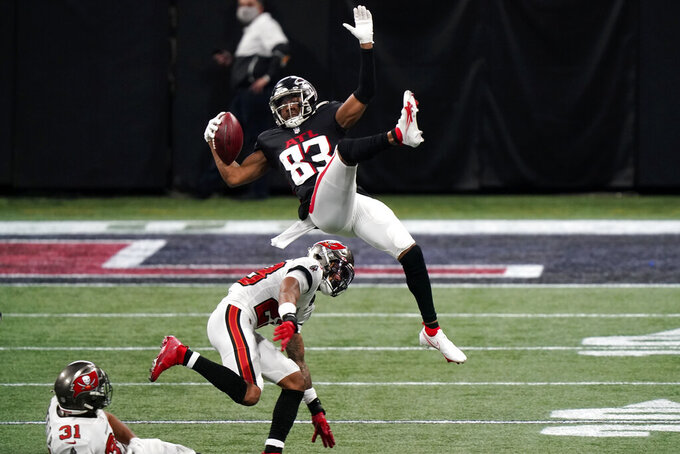 Atlanta Falcons wide receiver Russell Gage (83) leaps over Tampa Bay Buccaneers cornerback Ryan Smith (29) during the first half of an NFL football game, Sunday, Dec. 20, 2020, in Atlanta. (AP Photo/Brynn Anderson)