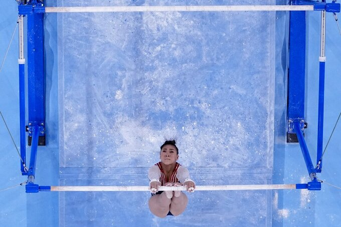 Sunisa Lee, of the United States, performs on the uneven bars during the artistic gymnastics women's all-around final at the 2020 Summer Olympics, Thursday, July 29, 2021, in Tokyo. (AP Photo/Morry Gash)