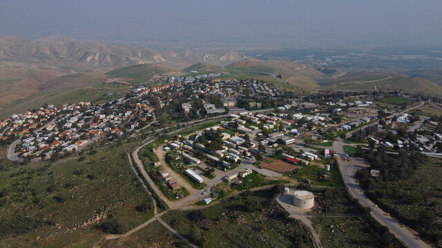 FILE - In this Tuesday, Feb. 18, 2020 photo, a view of the West Bank settlement of Ma'ale Efraim on the hills of the Jordan Valley. An Israeli watchdog group tells The Associated Press that Israel's settlement activity in the West Bank surged ahead in 2019, maintaining a rapid pace that has drawn strength from the friendly policies of the Trump administration.   (AP Photo/Ariel Schalit)