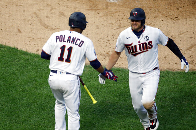 Minnesota Twins' Josh Donaldson, right, is congratulated by Jorge Polanco after Donaldson's solo home run off St. Louis Cardinals pitcher Carlos Martinez during the fourth inning of a baseball game Tuesday, July 28, 2020, in Minneapolis. (AP Photo/Jim Mone)