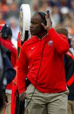 Liberty head coach Turner Gill looks on between plays against Auburn during the first half of an NCAA college football game, Saturday, Nov. 17, 2018, in Auburn, Ala. (AP Photo/Vasha Hunt)