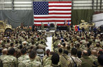 FILE- in this Sunday, Dec. 24, 2017, photo, Gen. Joseph Dunford, chairman of the Joint Chiefs of Staff speaks during a ceremony on Christmas Eve at a U.S. airfield in Bagram, north of Kabul, Afghanistan. The U.S. military has begun shipping equipment and winding down contracts with local service providers ahead of the May 1 start of the final phase of its military pullout from Afghanistan, a U.S. Defense Department official said Thursday, April 22, 2021.  (AP Photo/Rahmat Gul, File)