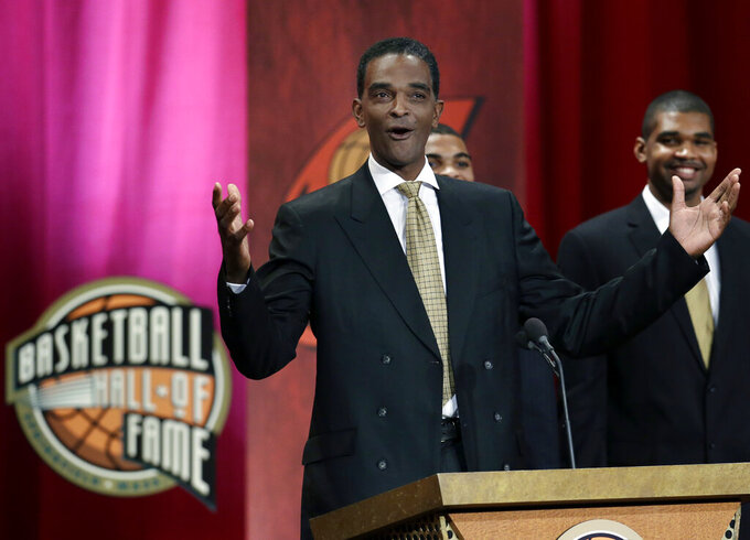 FILE - In this Sept. 7, 2012, file photo, inductee Ralph Sampson reacts as he speaks during the enshrinement ceremony for the 2012 class of the Naismith Memorial Basketball Hall of Fame at Symphony Hall in Springfield, Mass. Virginia's basketball program, which gave us one of the sport's greatest players in Sampson and its two biggest upsets, by Division II Chaminade and the world's most famous 16 seed in UMBC, is now on the verge of writing a new chapter _ one that would not be appreciated by nearly as many people were it not for the huge platform Virginia hoops helped create. (AP Photo/Elise Amendola, File)
