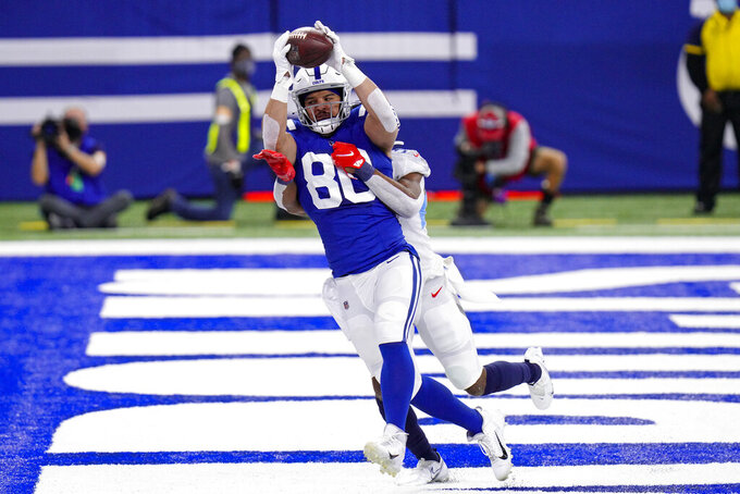 Indianapolis Colts tight end Trey Burton (80) makes a catch in front of Tennessee Titans free safety Kevin Byard for a touchdown in the first half of an NFL football game in Indianapolis, Sunday, Nov. 29, 2020. (AP Photo/AJ Mast)