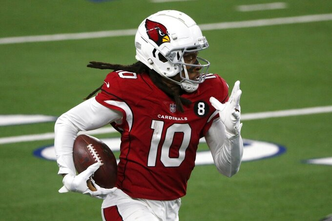 Arizona Cardinals wide receiver DeAndre Hopkins (10) gains yardage after catching a pass in the second half of an NFL football game against the Dallas Cowboys in Arlington, Texas, Monday, Oct. 19, 2020. (AP Photo/Michael Ainsworth)
