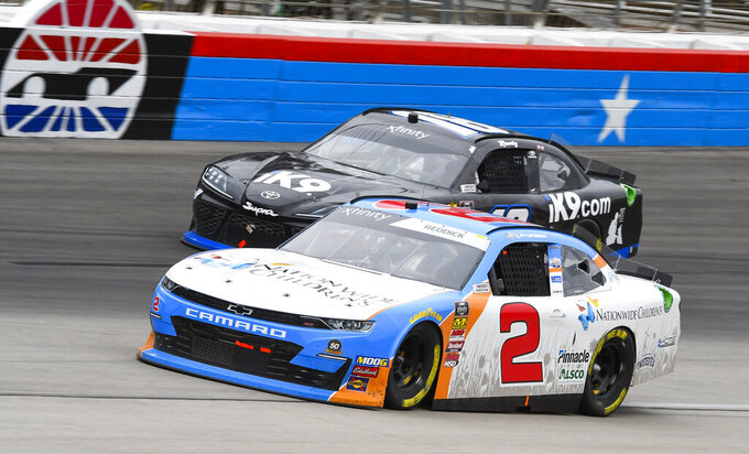 Drivers Tyler Reddick (2) and Kyle Busch battle for position during a NASCAR auto race at Texas Motor Speedway, Saturday, March 30, 2019, in Fort Worth, Texas. (AP Photo/Larry Papke)