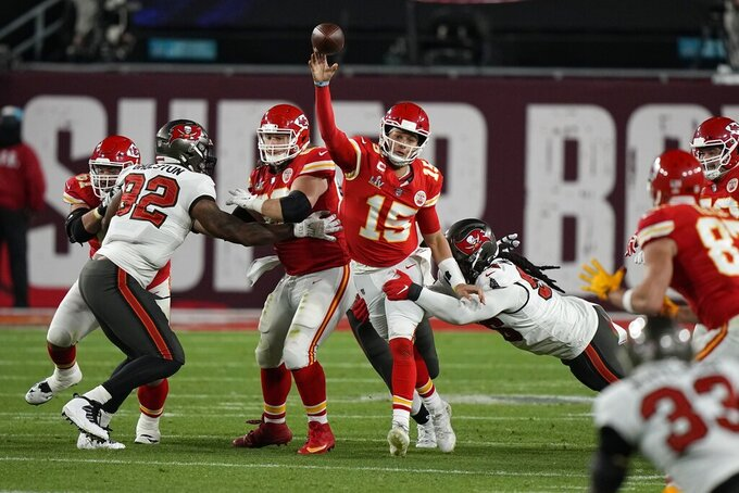 Kansas City Chiefs quarterback Patrick Mahomes throws against the Tampa Bay Buccaneers during the first half of the NFL Super Bowl 55 football game Sunday, Feb. 7, 2021, in Tampa, Fla. (AP Photo/David J. Phillip)