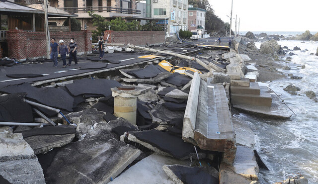 A coastal road is damaged in Ulsan, South Korea, Monday, Sept. 7, 2020. A powerful typhoon damaged buildings, flooded roads and knocked out power to thousands of homes in South Korea on Monday after battering islands in southern Japan and injuring dozens of people. (Kim Yong-tai/Yonhap via AP)