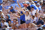 Fans wave from the stands during an NCAA college football game between Hawaii and UCLA on Saturday, Aug. 28, 2021, in Pasadena, Calif. (AP Photo/Ashley Landis)
