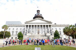 Protesters from conservative organizations, including the Greenville TEA Party and South Carolina Patriots for Liberty, gather without masks outside the South Carolina Statehouse in Columbia, S.C., Tuesday, Sept. 15, 2020. The groups called on Gov. Henry McMaster and other state and local leaders to end gathering and business restrictions and mask mandates issued to limit the spread of COVID-19. (AP Photo/Michelle Liu)