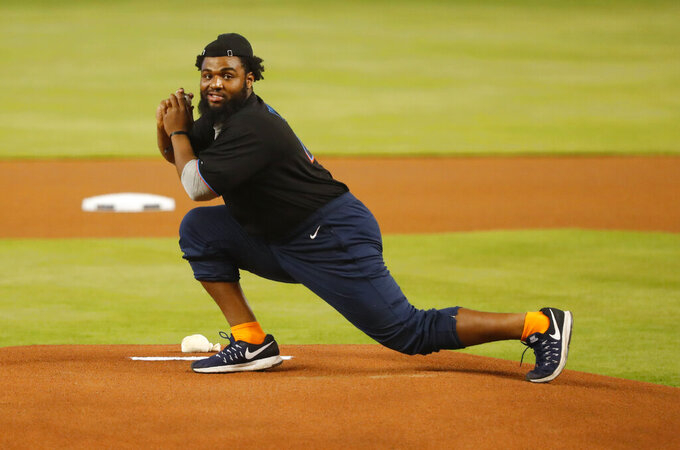 Miami Dolphins first-round pick Christian Wilkins prepares to throw a ceremonial first pitch before a baseball game between the Miami Marlins and the St. Louis Cardinals, Wednesday, June 12, 2019, in Miami. (AP Photo/Wilfredo Lee)