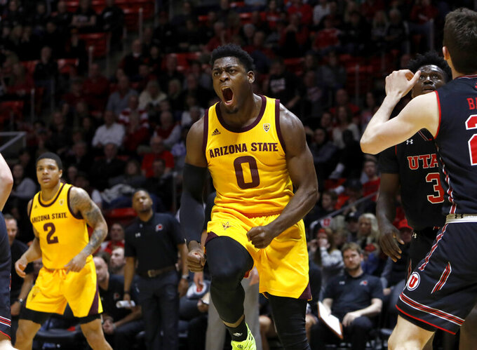 Arizona State's Luguentz Dort (0) celebrates after scoring with a layup during the first half of the team's NCAA college basketball game against Utah on Saturday, Feb. 16, 2019, in Salt Lake City. (AP Photo/Kim Raff)
