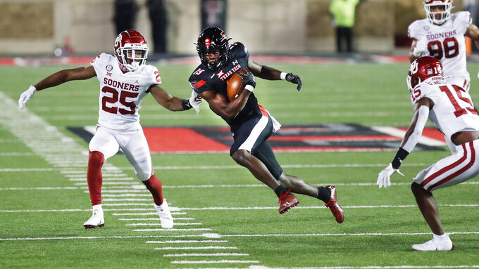 Texas Tech wide receiver Loic Fouonji carries the ball before being tackled by Oklahoma safety Justin Broiles during the second half of an NCAA college football game, Saturday, Oct. 31, 2020, in Lubbock, Texas. (AP Photo/Mark Rogers)
