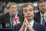 "FILE - In this Wednesday March 27, 2019 file photo, former U.K. Independence Party (UKIP) leader and member of the European Parliament Nigel Farage at the European Parliament in Strasbourg, France. Farage, the self-declared ""pantomime villain"" of Brexit, told the Associated Press Tuesday Jan. 14, 2020, he is leaving the European Union's parliament in Strasbourg later this week with a sense of mission accomplished. (AP Photo/Jean-Francois Badias, File)"