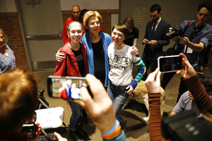 Sen. Elizabeth Warren, D-Mass., poses for a photo with a local residents during an organizing event, Sunday, Feb. 10, 2019, in Cedar Rapids, Iowa.(AP Photo/Charlie Neibergall)