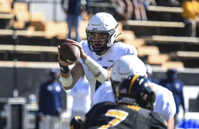 Rice quarterback Mike Collins gets the snap during the team's NCAA college football game against Southern Mississippi in Hattiesburg, Miss., Saturday, Oct. 31, 2020. (Cam Bonelli/Hattiesburg American via AP)