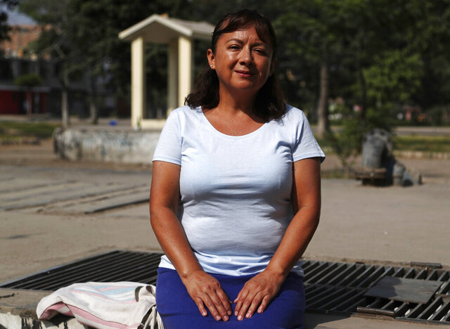 In this Feb. 6, 2020, photo, Peruvian Margarita Del Pilar Fitzpatrick, poses for a portrait at San Martin de Porres neighborhood in Lima, Peru. The day Fitzpatrick applied for an Illinois driver's license upended her life. When a clerk offered to register her to vote, the Peruvian citizen mistakenly accepted, leading to long legal battles and eventually deportation. (AP Photo/Martin Mejia)