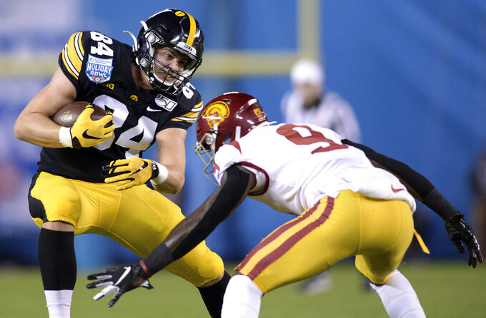 Iowa tight end Sam LaPorta (84) runs with the ball while defended by Southern California cornerback Greg Johnson (9) during the first half of the Holiday Bowl NCAA college football game Friday, Dec. 27, 2019, in San Diego. (AP Photo/Orlando Ramirez)