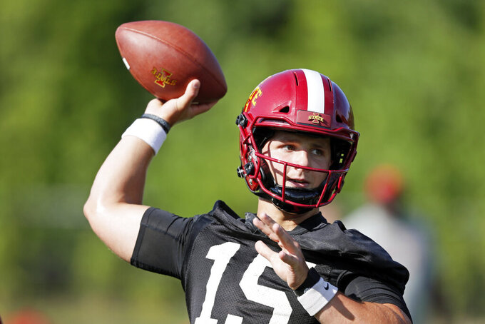 FILE - In this Aug. 2, 2019, file photo, Iowa State quarterback Brock Purdy throws a pass during an NCAA college football practice in Ames, Iowa. The Cyclones were ranked in the preseason poll for the first time in 41 years behind a punishing defense, a young quarterback who seems destined for stardom and a coach who always seems to push the right buttons. (AP Photo/Charlie Neibergall, File)