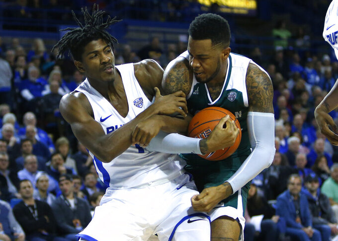 Buffalo forward Jeenathan Williams (11) and Eastern Michigan center Jason Thompson IV during the second half of an NCAA college basketball game, Friday, Jan. 18, 2019, in Buffalo N.Y. (AP Photo/Jeffrey T. Barnes)