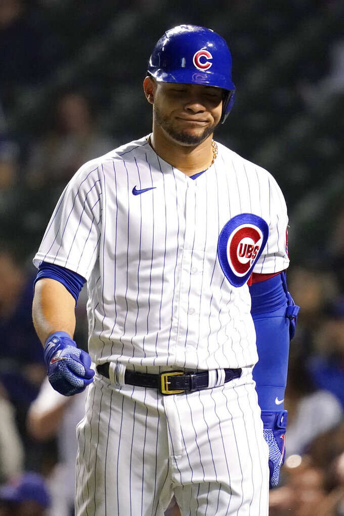 Chicago Cubs' Willson Contreras reacts after striking out swinging during the fifth inning of a baseball game against the Washington Nationals in Chicago, Wednesday, May 19, 2021. (AP Photo/Nam Y. Huh)