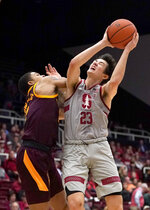 Stanford guard Cormac Ryan (23) is fouled by Arizona State guard Rob Edwards, left, during the first half of an NCAA college basketball game in Stanford, Calif., Saturday, Jan. 12, 2019. (AP Photo/Tony Avelar)