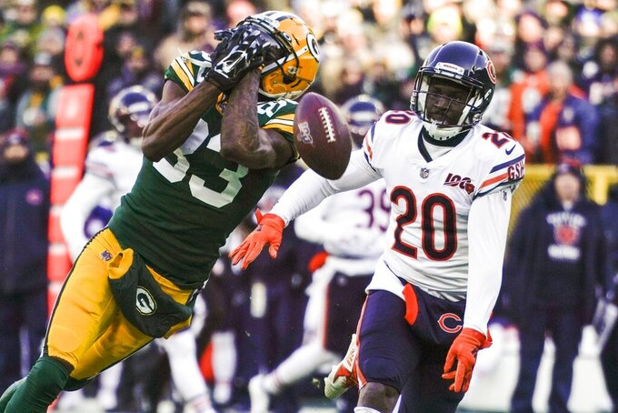 Green Bay Packers' Marquez Valdes-Scantling can't catch a pass in front of Chicago Bears' Prince Amukamara during the first half of an NFL football game Sunday, Dec. 15, 2019, in Green Bay, Wis. (AP Photo/Morry Gash)