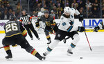 San Jose Sharks defenseman Brent Burns (88) skates up the ice next to Vegas Golden Knights center Paul Stastny (26) during the first period of an NHL hockey game Thursday, Nov. 21, 2019, in Las Vegas. (AP Photo/John Locher)
