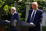 President Donald Trump listens as Mexican President Andres Manuel Lopez Obrador speaks during an event in the Rose Garden at the White House, Wednesday, July 8, 2020, in Washington. (AP Photo/Evan Vucci)