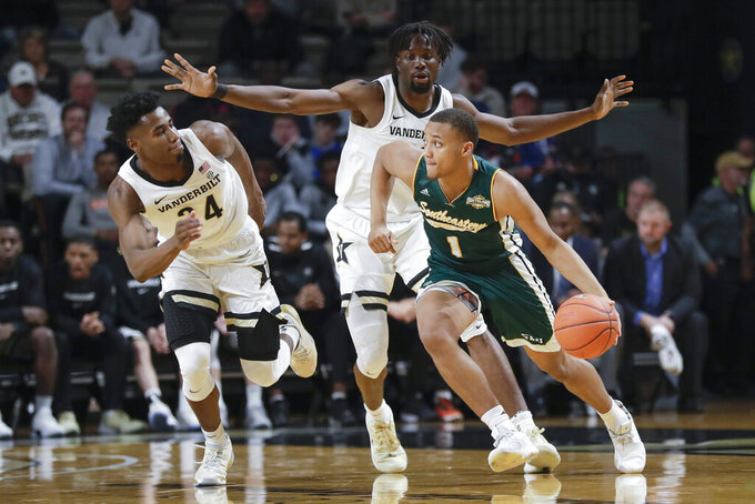 Southeastern Louisiana guard Jeremiah Saunders (1) drives against Vanderbilt defenders Aaron Nesmith (24) and Ejike Obinna, center, in the first half of an NCAA college basketball game Monday, Nov. 25, 2019, in Nashville, Tenn. (AP Photo/Mark Humphrey)