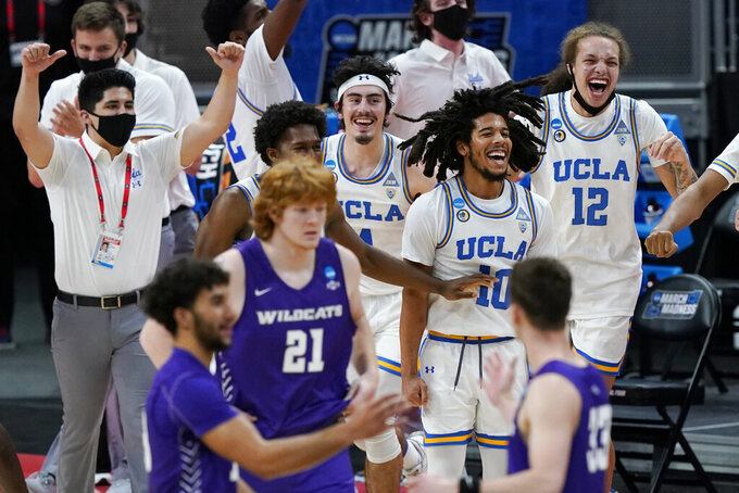 UCLA players celebrate as time expires during their win over Abilene Christian in a college basketball game in the second round of the NCAA tournament at Bankers Life Fieldhouse in Indianapolis Monday, March 22, 2021. (AP Photo/Mark Humphrey)