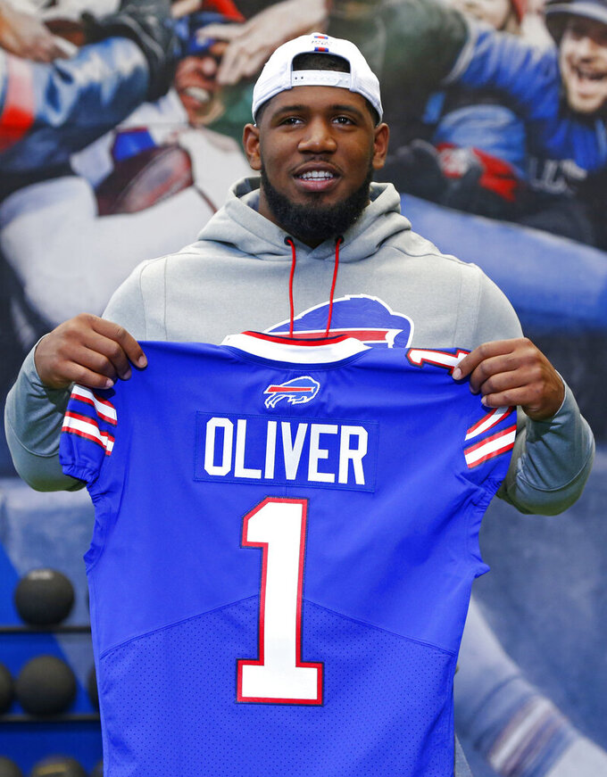Buffalo Bills first-round draft pick Ed Oliver poses for photographs following an NFL football news conference Friday, April 27, 2019, in Orchard Park N.Y. (AP Photo/Jeffrey T. Barnes)
