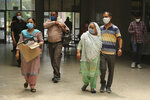 Indians wearing face masks arrive to consult doctors at COVID-19 screening facility inside a government run hospital in Jammu, Saturday, June 27, 2020. India is the fourth hardest-hit country by the pandemic in the world after the U.S., Russia and Brazil. (AP Photo/Channi Anand)