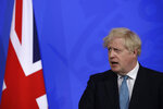 Britain's Prime Minister Boris Johnson speaking at a press conference about the ongoing coronavirus outbreak, in London, Friday, May 14, 2021. (AP Photo/Matt Dunham, Pool)