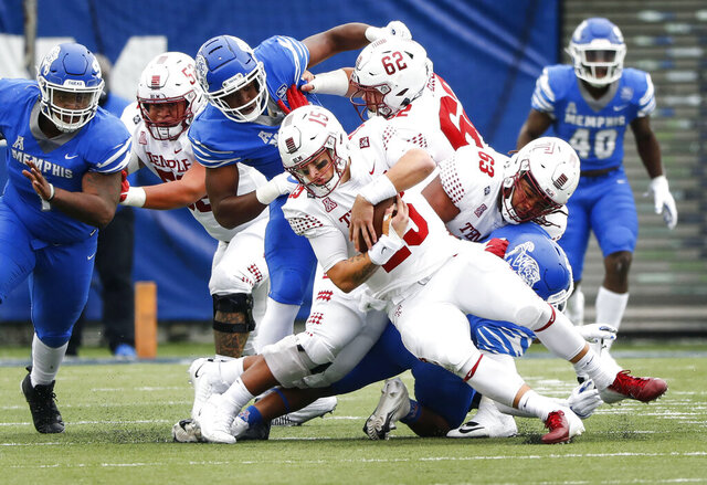 Temple quarterback Anthony Russo, center, is sacked by the Memphis defense  during an NCAA college football game Saturday, Oct. 24, 2020, in Memphis, Tenn. (Mark Weber/Daily Memphian via AP)